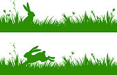 Easter design elements with silhouette of spring grass and rabbit isolated on white background. Vector Illustration.