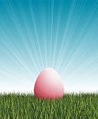 istock Easter egg, grass and light effects on blue sky 1297772219