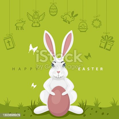 istock Easter Egg Hunt Party. Bunny on green grass. 1303898929