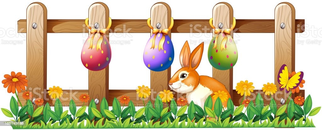 Easter eggs at the fence and a bunny royalty-free stock vector art