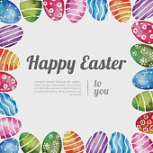 Vibrant Easter frame with hand painted eggs and copy space text.
