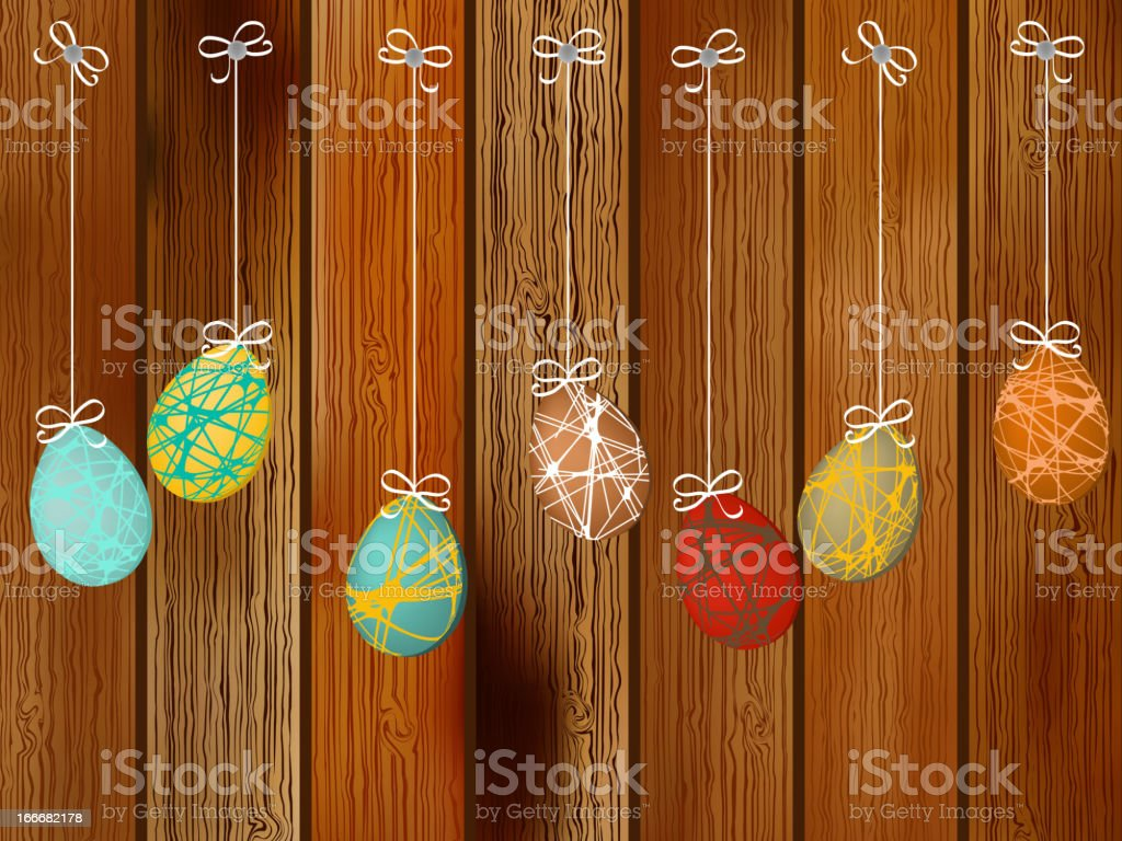 Easter eggs on a wooden wall.  + EPS8 royalty-free stock vector art