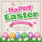 "Easter Eggs on Wood background with text ""Happy Easter"""
