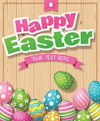 """Colorful Easter eggs against a wood background with text """"Happy Easter""""."""