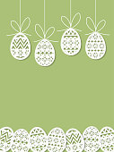 Easter eggs paper cut art on green background