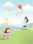 Little boy flying his kite, his sister is collecting easter eggs.