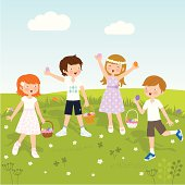 Group of children having fun at an Easter egg hunt