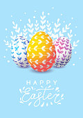 Easter greeting card with color decorated eggs on blue background