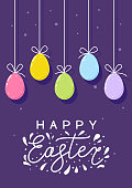 Easter greeting card with color eggs on purple