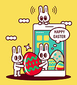 istock Easter greetings with smartphone, happy Easter bunny turning up on smartphone screen and sending Easter Eggs 1303412137