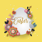 Easter holiday banner design with paper cut flowers and bunnies.