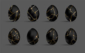 Easter kintsugi black eggs set. Luxury eggs with different crackle gold ornament. Spring holiday. Realistic vector illustration. For greeting card, promotion, poster, flyer, banner, social media.