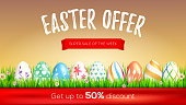 Easter sale, limited offer. Get up to 50 percent discount. Design of promotional text on red ribbons. Set of hand-painting Easter eggs in green spring grass. Festive discount actions