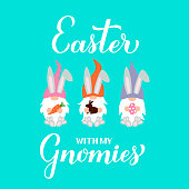 Easter with my gnomies calligraphy hand lettering with cute gnomes holding egg, chocolate bunny and carrot. Vector template for typography poster, greeting card, banner, sticker, etc.