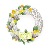 Easter wreath - elegant decorated wreath with eggs flowers and leafs - yellow orange white and green color