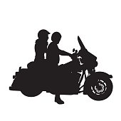 A vector silhouette illustration of a man and woman riding a motorcycle.  The man drives while the woman rides in the rear.