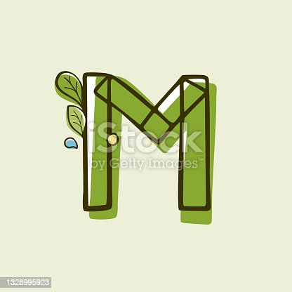 istock Eco style letter M logo hand-drawn with a marker with paint shift effect. 1328995923