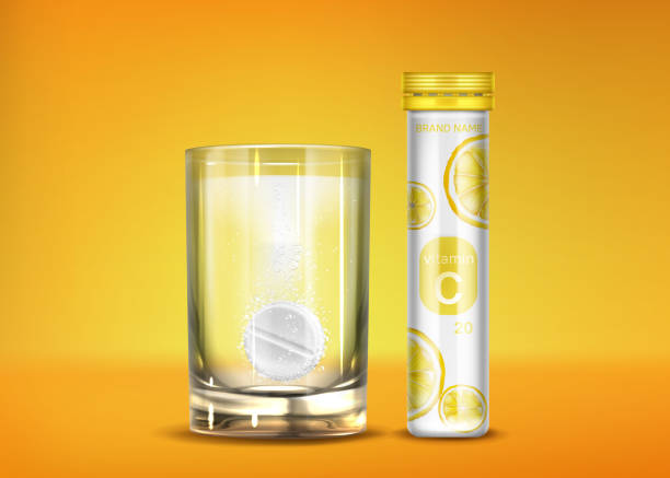 Effervescent vitamin C pills with fizz bubbles Effervescent vitamin C pills with fizz bubbles in water glass and closed bottle. Soluble tablets, pharmaceutical remedy capsules, isolated on orange background. Realistic 3d vector illustration aspirin stock illustrations