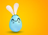 Vector lettering for Easter. Vector banner with lettering Happy Easter and egg with kawaii face. Vector cute egg with bunny ears in kawaii style.