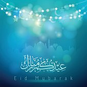 Eid mubarak arabic calligraphy mosque silhouette Glow Crescent and star