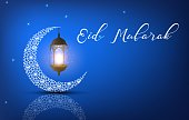 Vector illustration of Eid Mubarak background with arabic lantern and crescent moon