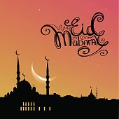 Arabic islamic holiday Eid Mubarak greeting card with mosque silhouette on sunset sky and handwritten lettering. Vector illustration