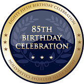Eighty fifth birthday celebration gold award with a laurel wreath and stars.