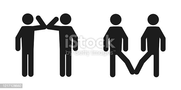 istock Elbow bump and foot tap icon. New greeting to avoid the spread of coronavirus. Two friends meet, instead of greeting with a hug or handshake, they bump elbows instead or touch their feet together 1217128552