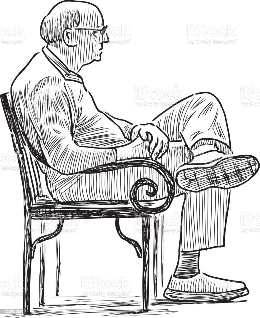 Elderly city dweller sits on the park bench