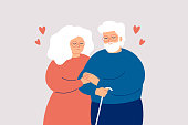 Elderly couple hold with hands. Senior man and woman stand together and embrace each other with love and care. Concept of medical insurance and help to mature people.