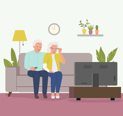Elderly couple sitting on the couch and watching TV . Vector flat cartoon illustration