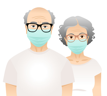Elderly man and woman in surgical masks