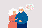 Elderly man with dementia needs help. Mature couple supports each other in the fight with amnesia and mental disorder. Memory loss concept.