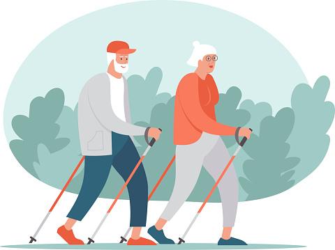 Elderly Senior couple making nordic walking training together