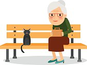 Elderly woman and cat sitting on park bench