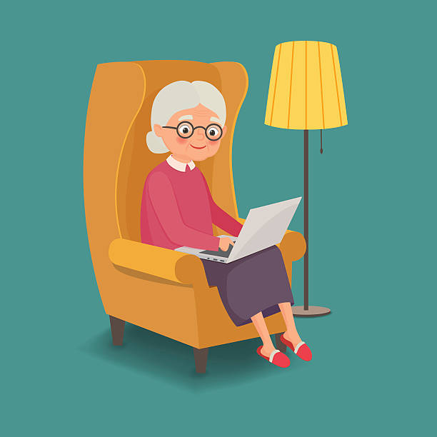 elderly woman sitting in a chair with a laptop - granny stock-grafiken, -clipart, -cartoons und -symbole