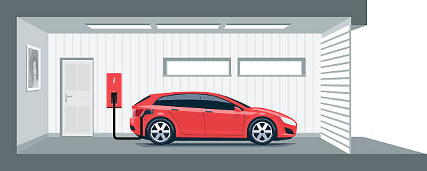 Electric Car Charging at Home in Garage Flat vector illustration of a red electric car charging at the charger station point inside home garage. Integrated smart domestic electromobility e-motion concept. electric vehicle charging station stock illustrations