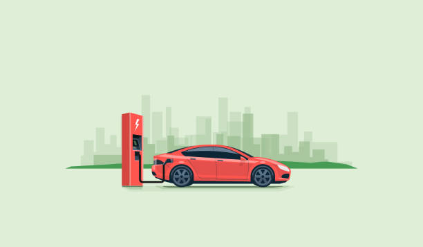 Electric Car Charging at the Charging Station Flat vector illustration of a red electric car charging at the charger station on the street with green city skyline in the background. Electromobility e-motion concept. electric vehicle charging station stock illustrations