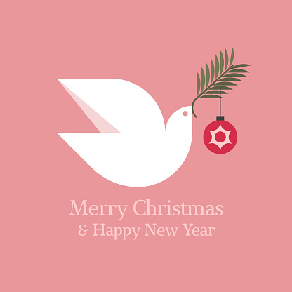 Elegant Christmas card with seasons greetings and white dove holding fir tree branch with christmas ball