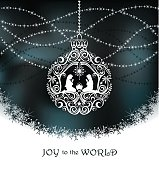 Stylized lace Christmas Ornament with Mary, Joseph, and baby Jesus. Snowflake bottom and dark blue sky  background with shiny beads. Joy to the World. Room for your copy.