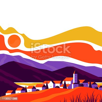 Elegant cityscape of small and cute village on a background of rocky mountains at sunset