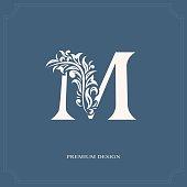 Elegant letter M. Graceful style. Calligraphic beautiful sign. Vintage drawn emblem for book design, brand name, business card, Restaurant, Boutique, Hotel. Vector illustration