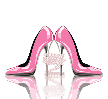 Elegant pink, high heel shoes with pearl jewelry. Shoes, symbol for wedding and engagement.