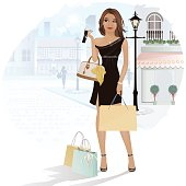 A stylish, elegant girl with shopping bags.  Add text or a logo to her shopping bag and there is lots room for text to the left of her.