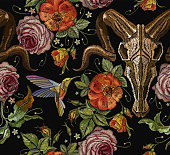Embroidery bull skull, hummingbird and roses seamless pattern. Dia de muertos, day of the dead. Gothic romanntic embroidery buffalo skulls red roses and peonies tribal pattern, clothes art