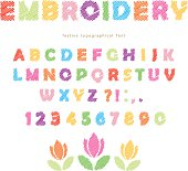 Embroidery colorful font design. Isolated on white. Vector