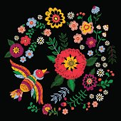 Embroidery ethnic colorful pattern with bird and fantasy flowers.