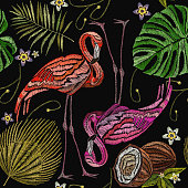 Embroidery flamingo , palm tree leaves, coconut tropical seamless pattern. Fashionable embroidery pink flamingos, tropical summer background. Fashionable template for design of clothes