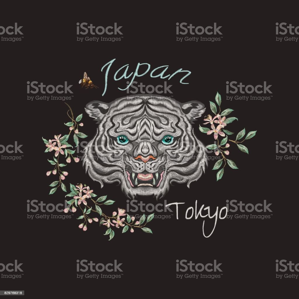 d07247946 Embroidery oriental patch with tiger head and orange flowers. -  Illustration .