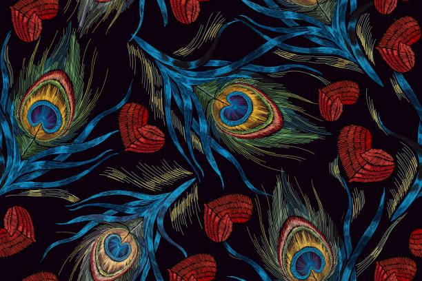 ilustrações de stock, clip art, desenhos animados e ícones de embroidery peacock feathers and hearts seamless pattern. symbol of love, passion. classical fashionable embroidery beautiful peacocks feathers and red heart. fashionable template design of clothes - pena de pássaro algodão